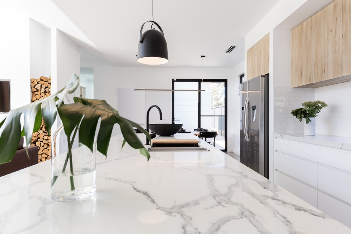 modern kitchen with white marble counters