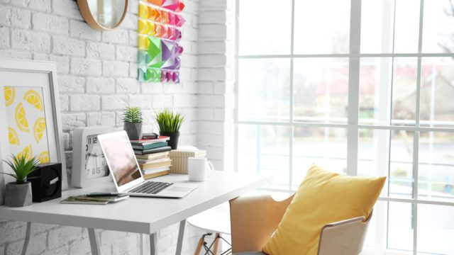 modern office with yellow pillow on white chair