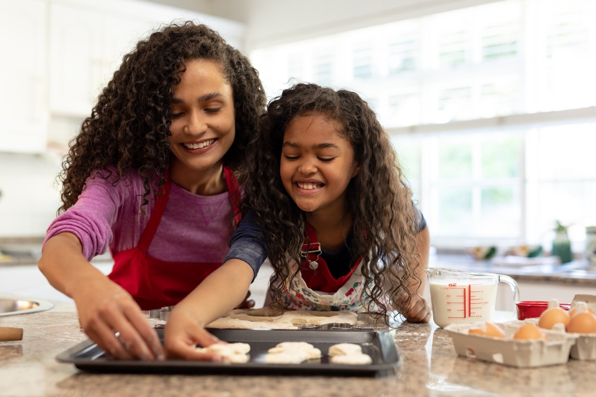 Mother and daughter making holiday cookies