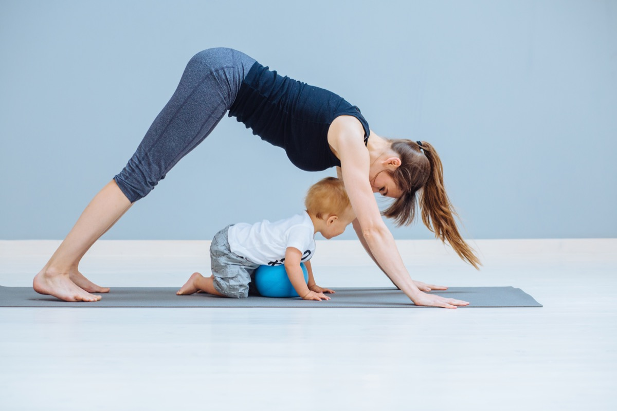 Mom working out at home with her baby