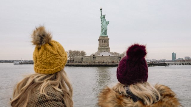 two girls in front of the new york city