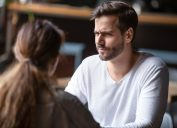 Doubting dissatisfied man looking at woman