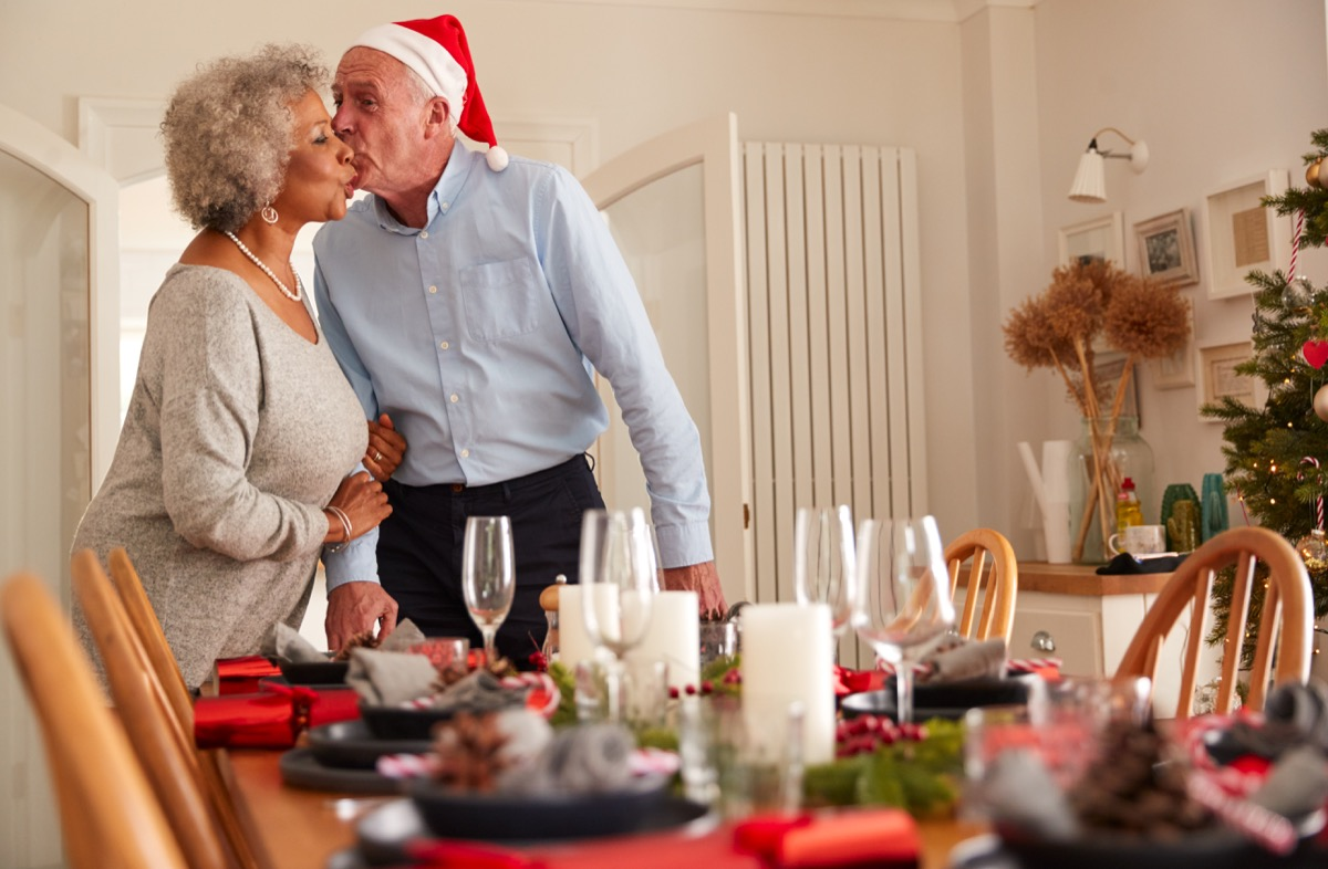 old couple setting up christmas dinner