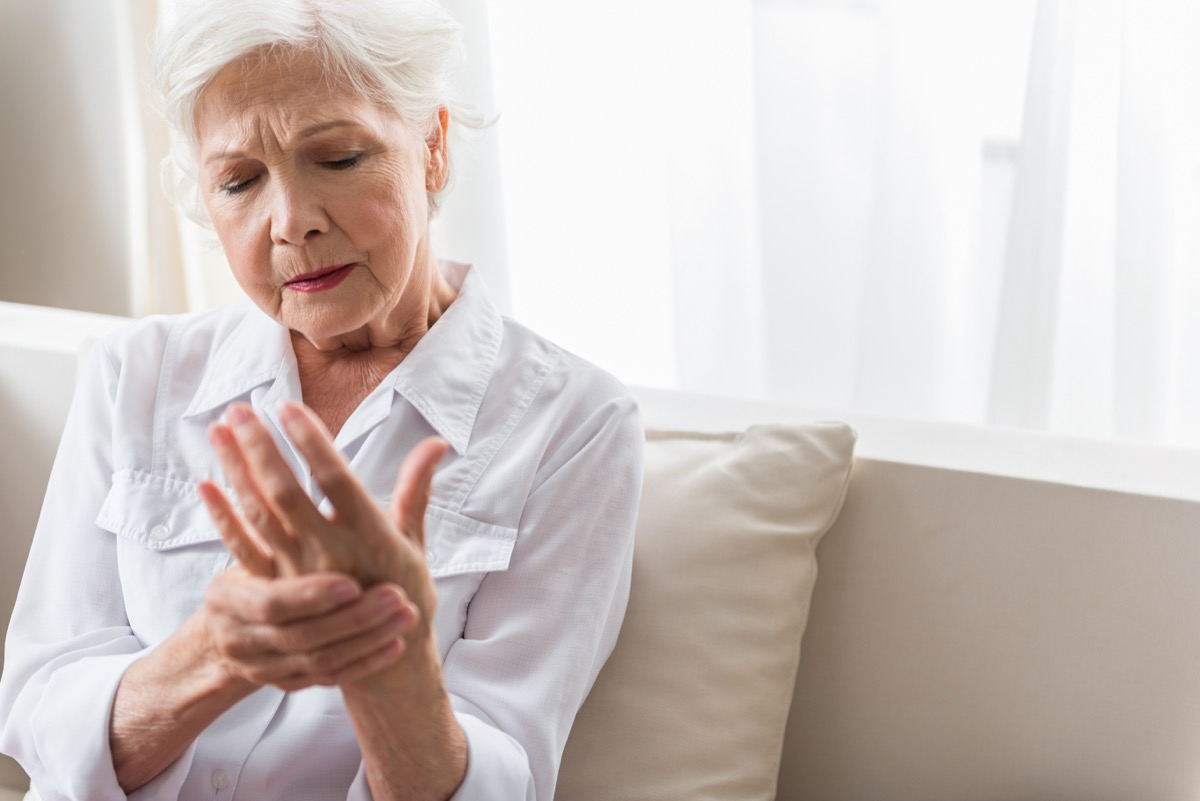 old woman rubbing her wrist