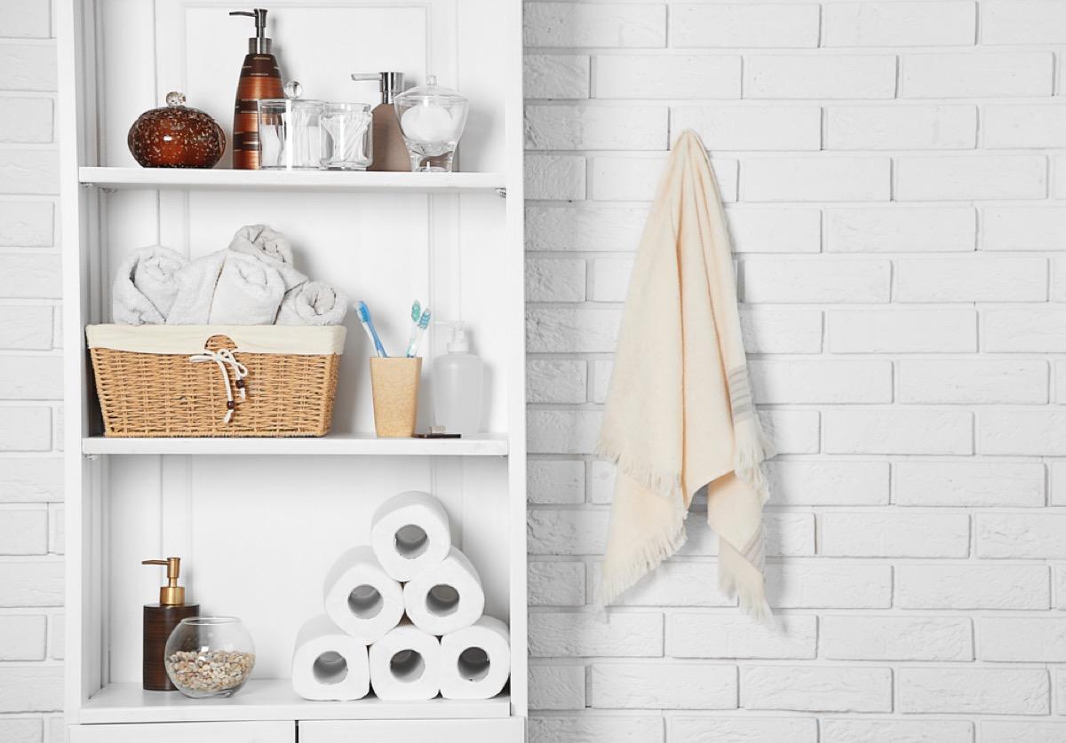 open shelves in white bathroom