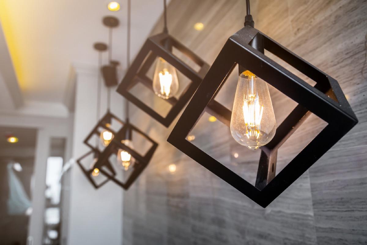 black cubic pendant lights with edison bulbs