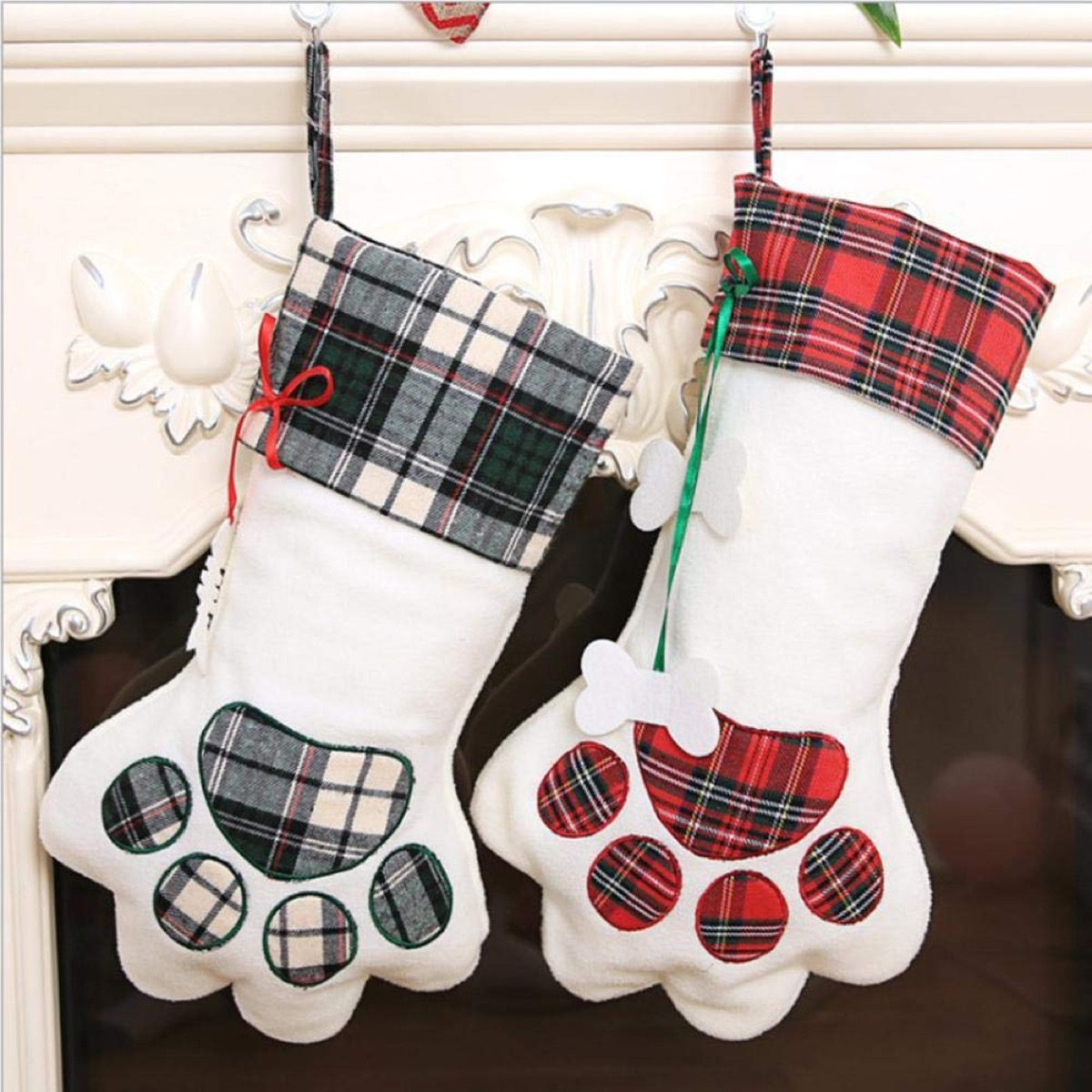 two plaid and white stockings in dog paw pattern