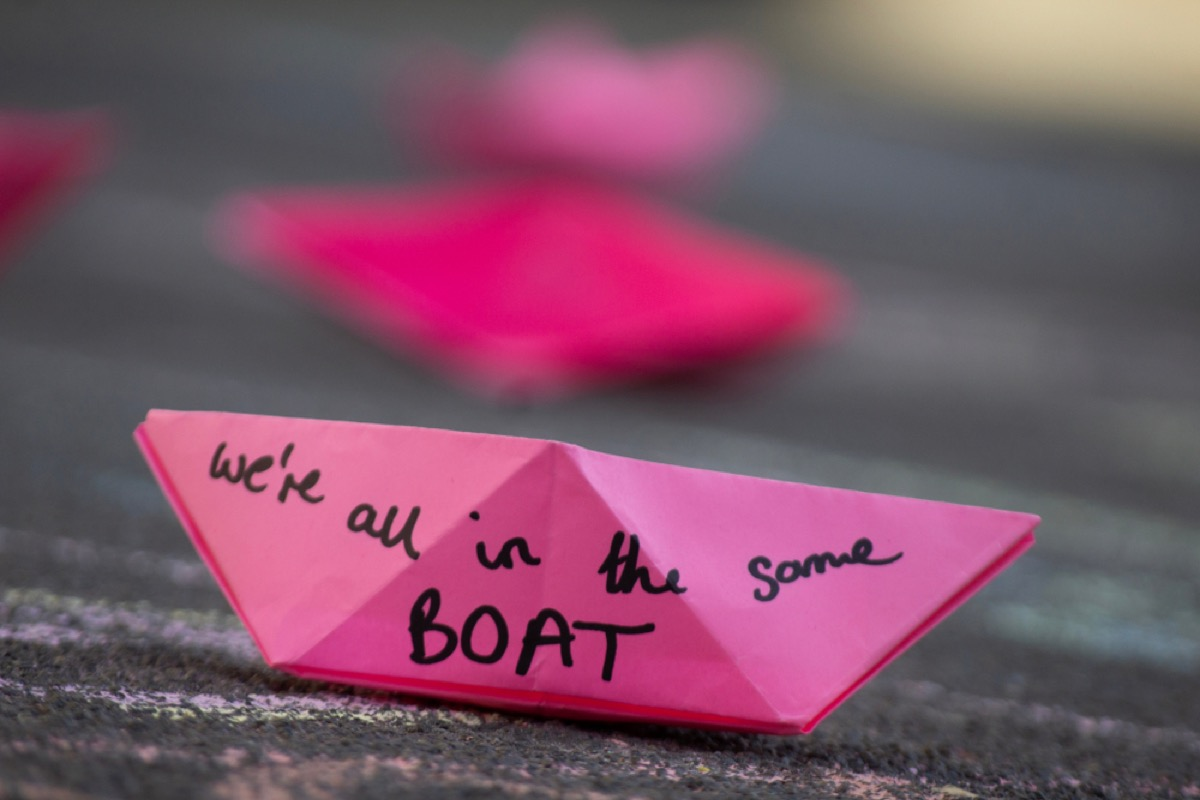 """plastic ban protests in Oxford Circus in London show little pink boats that read """"we're all in the same boat"""""""