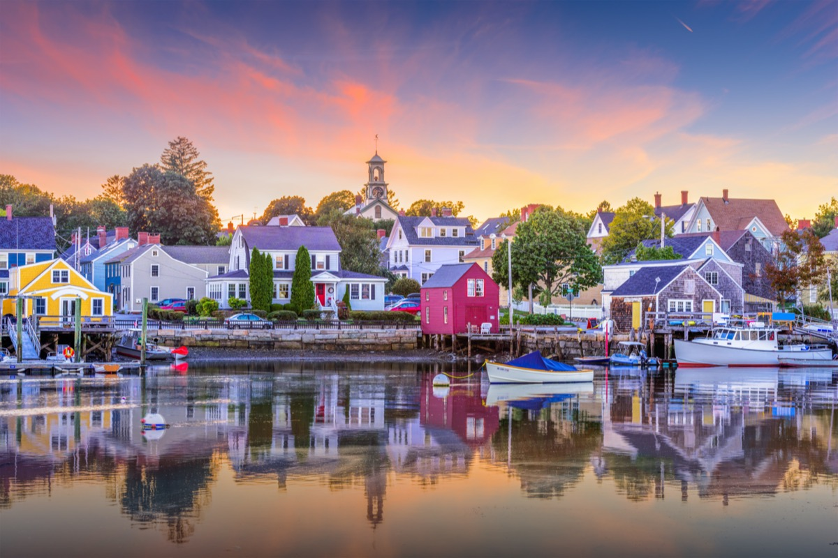 waterfront town with a harbor and boats at sunset
