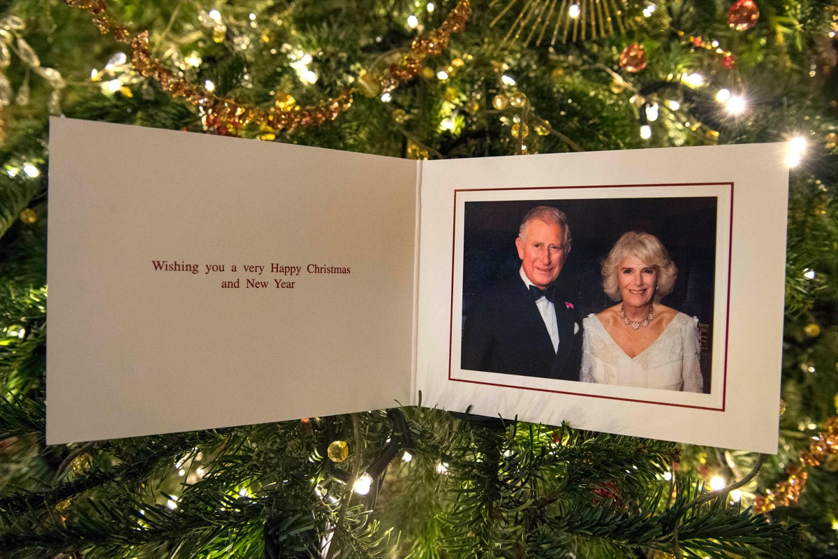 The Prince of Wales and Duchess of Cornwall's 2017 Christmas card on a Christmas tree in Clarence House, London. The picture on the card was taken by Hugo Burnand showing the royal couple in the Orchard Room during the private 70th birthday party of The D