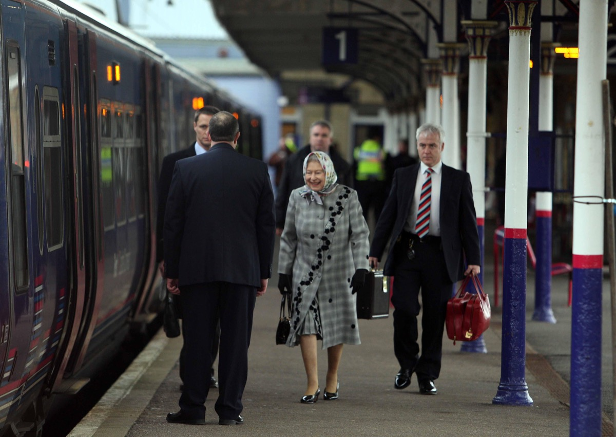 Queen Elizabeth boarding a train to her country home