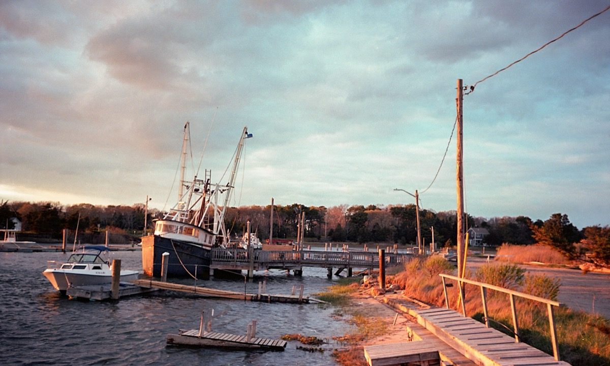 boats at a harbor during sunset