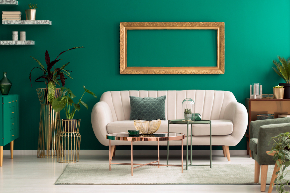 round couch against green wall
