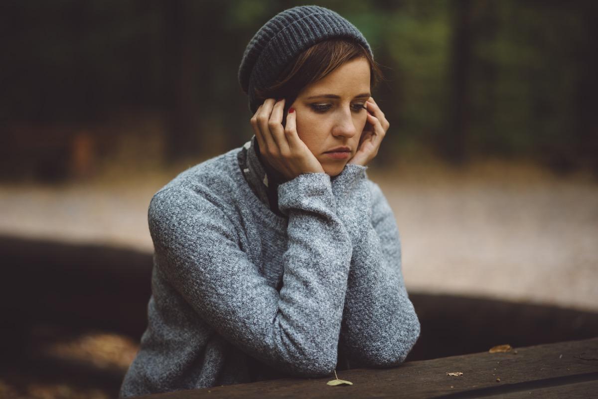 sad woman standing alone