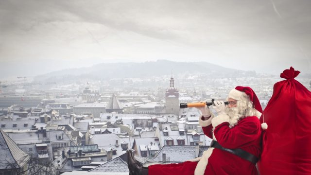 santa claus looking over the city