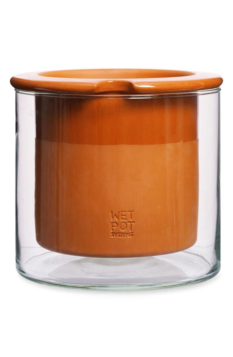 terra cotta pot in glass container
