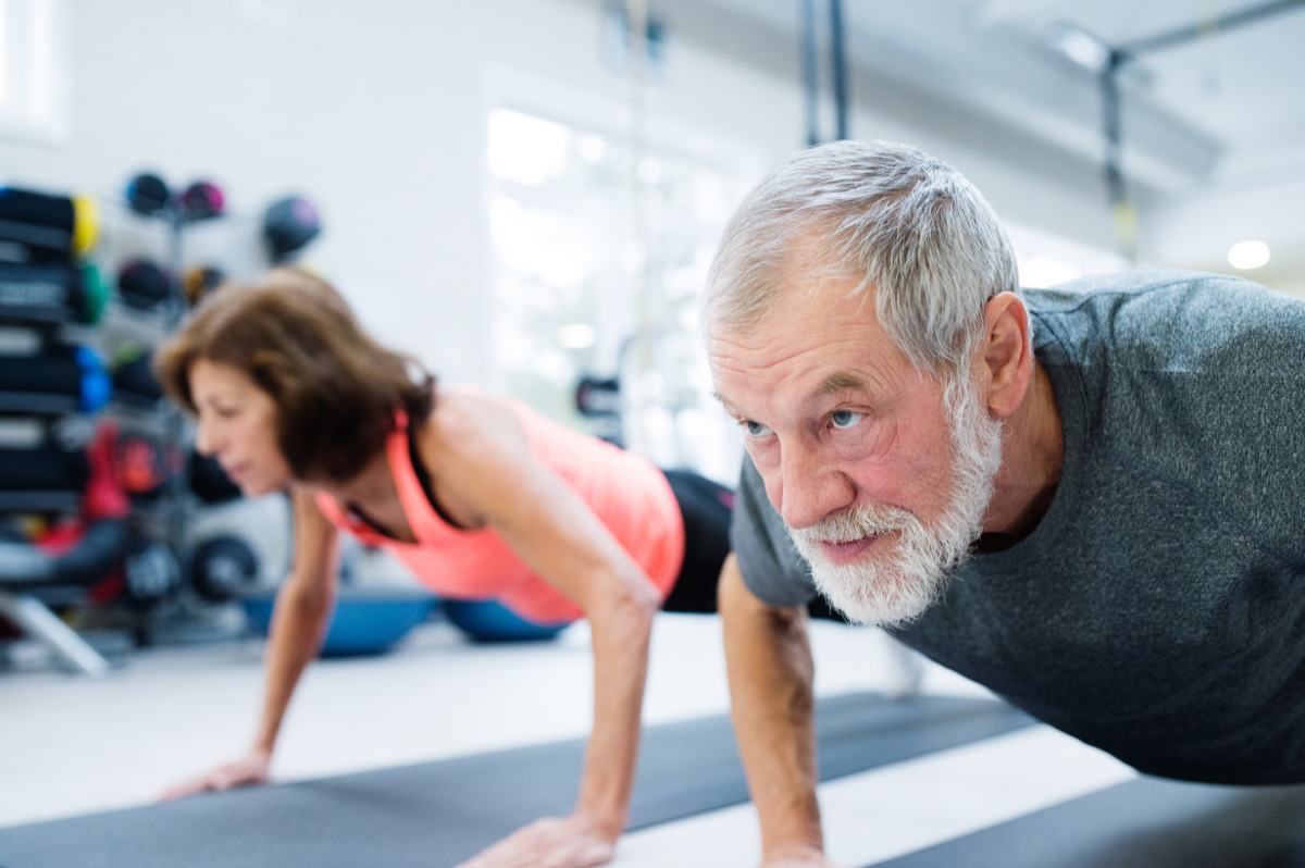 senior couple doing push ups