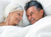 senior couple in bed together