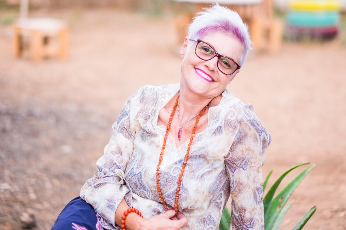 senior woman with pink hair