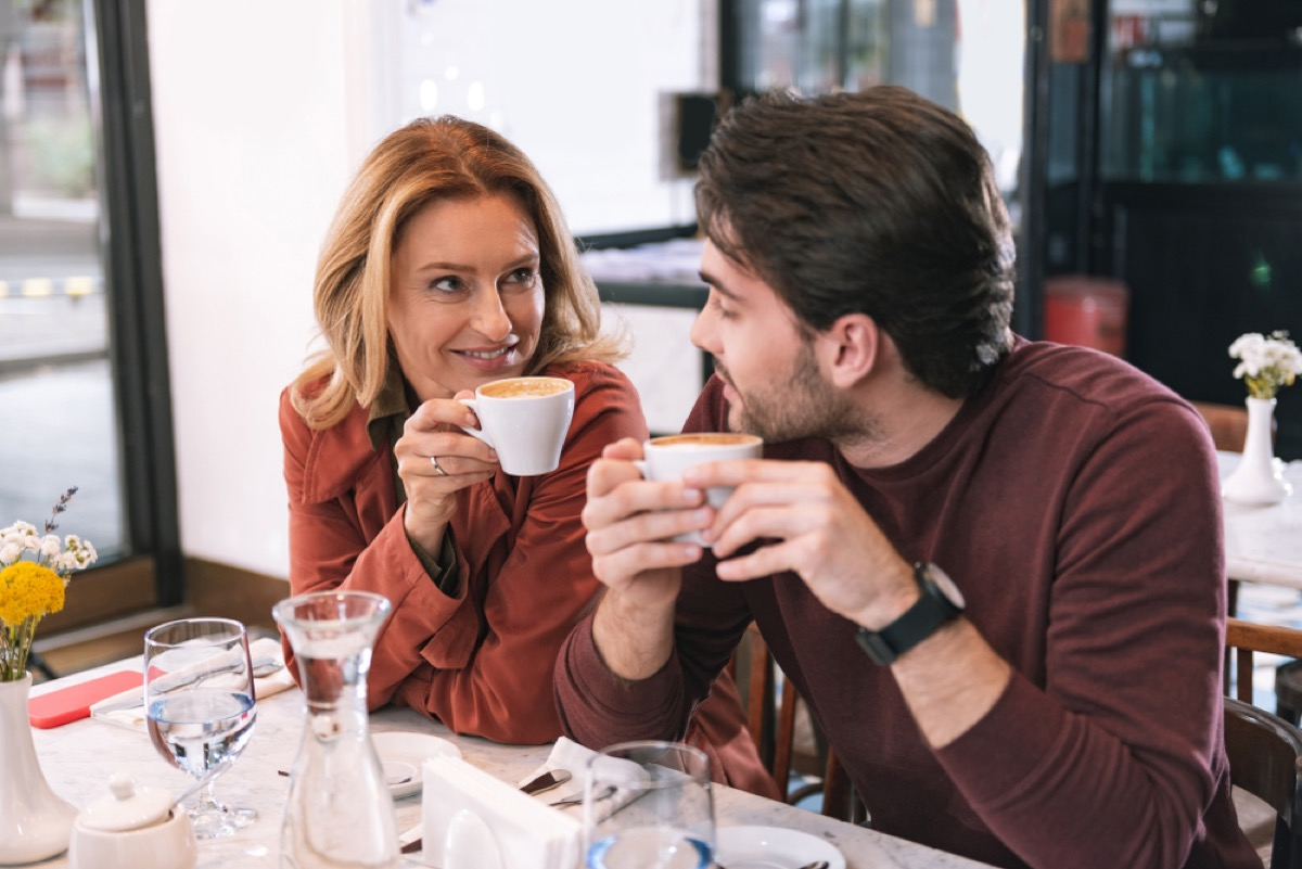 middle aged white woman having coffee with a younger white man