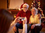 elderly couple takes photo at christmas