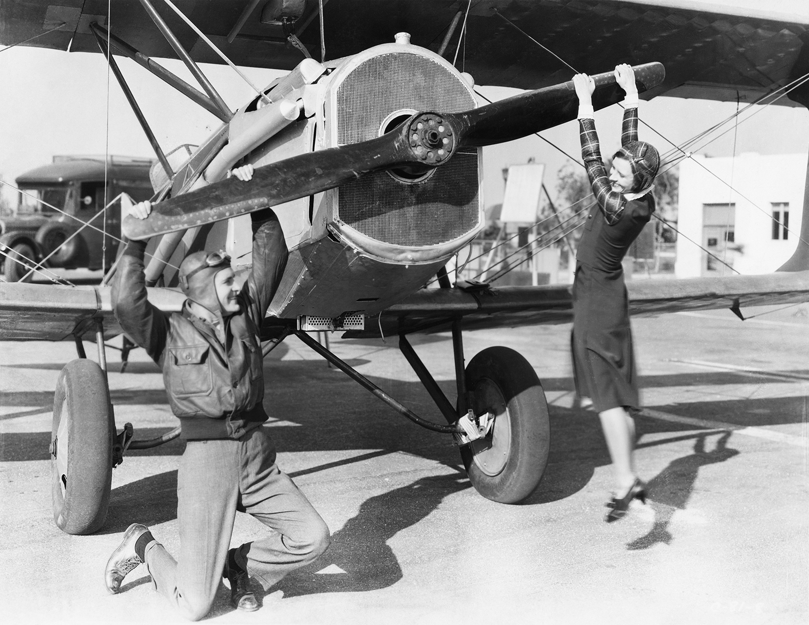 a man and a woman play with a plane propeller