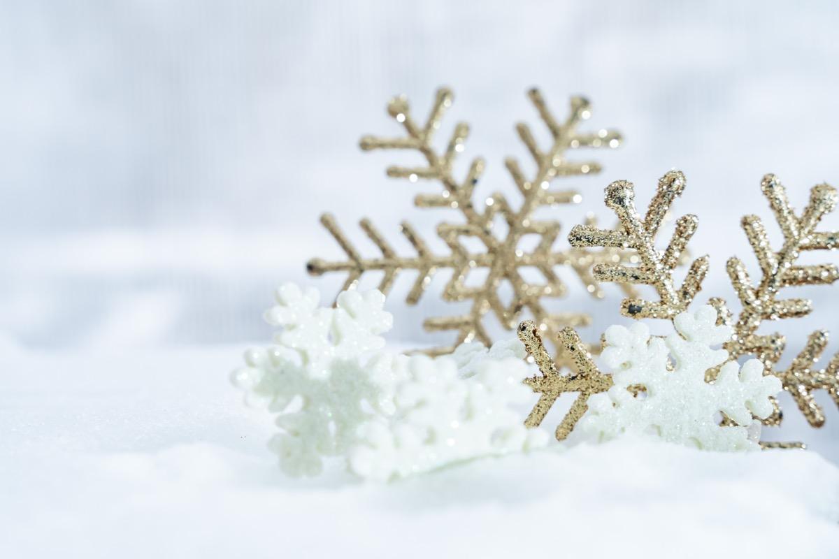 snowflake ornaments on snow