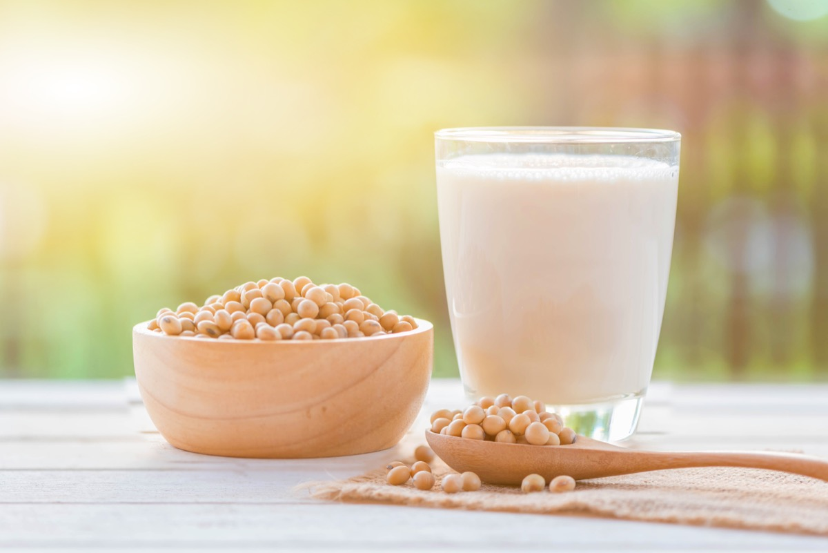 soy milk and soy beans on table