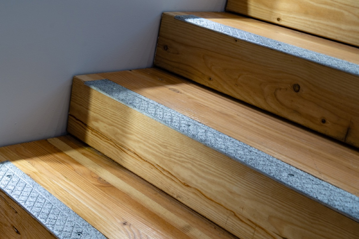 wooden stairs with gray treads