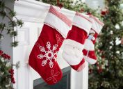 red and white stockings hung on mantle