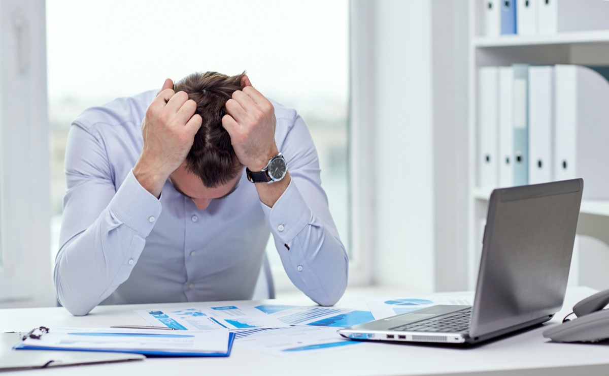stressed businessman at his desk