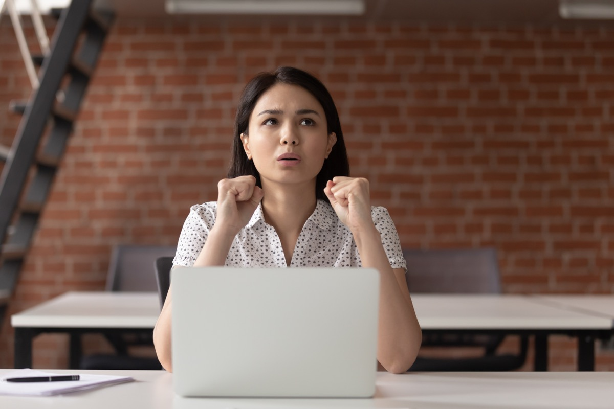 stressed woman sitting in front of laptop