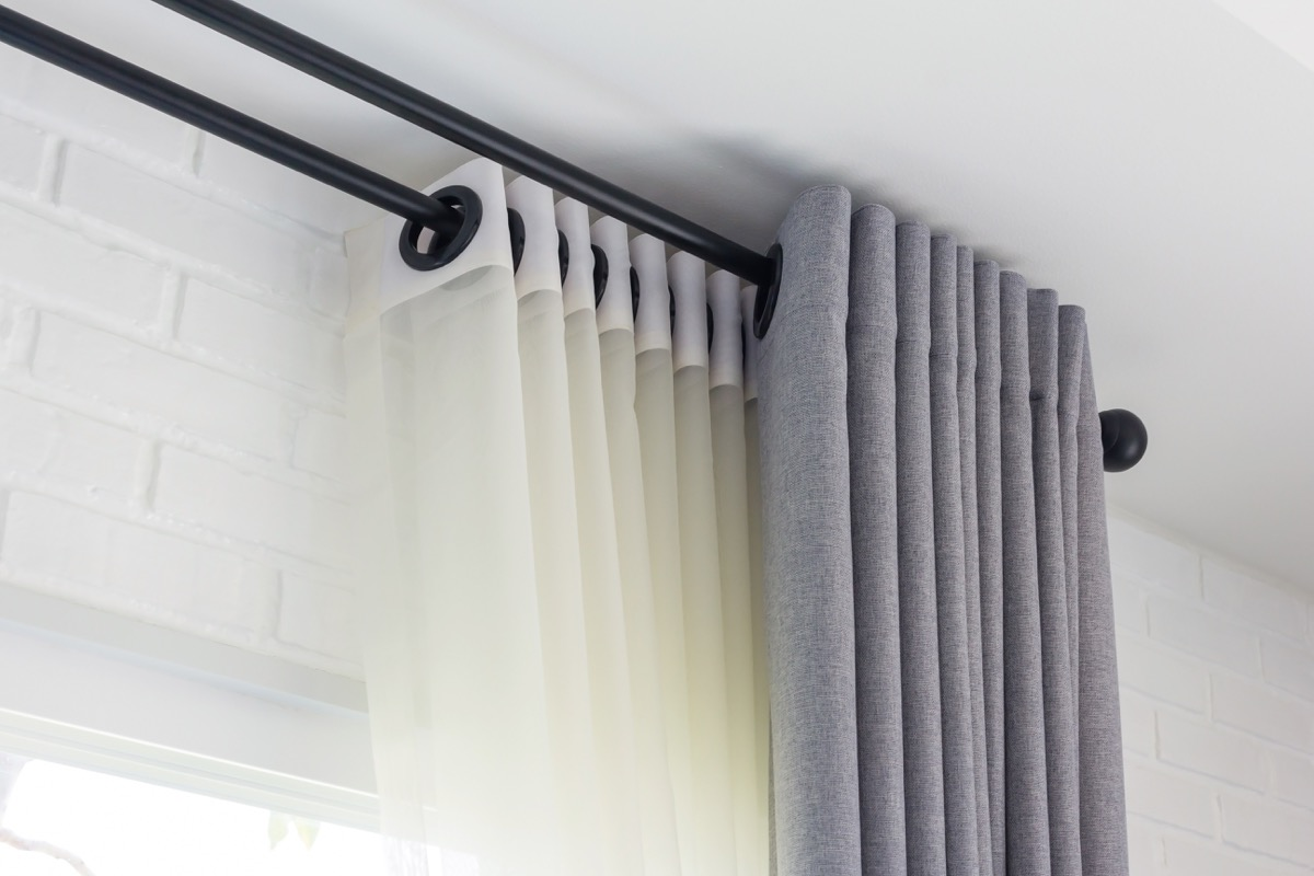 gray curtains over sheer panels
