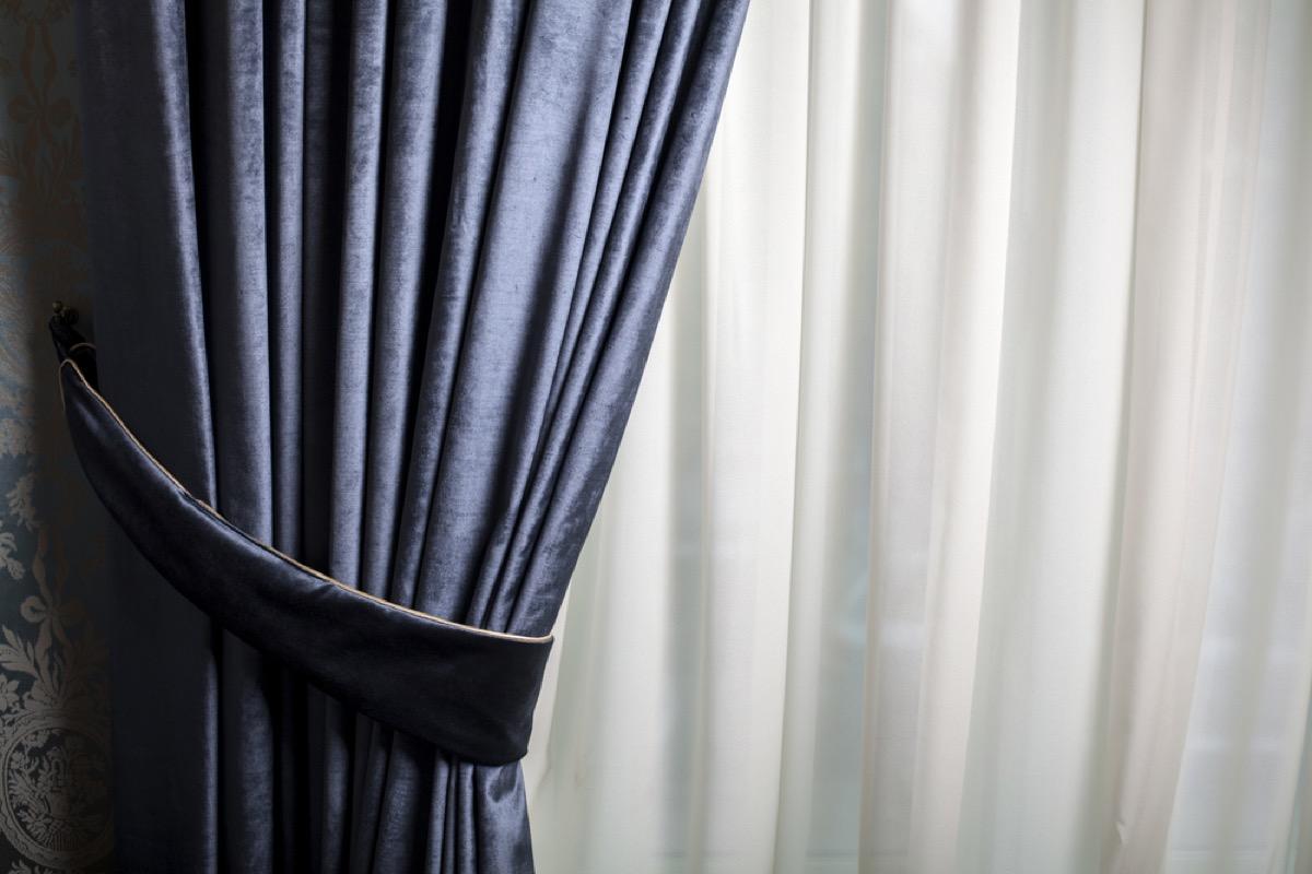 blue velvet curtain on window