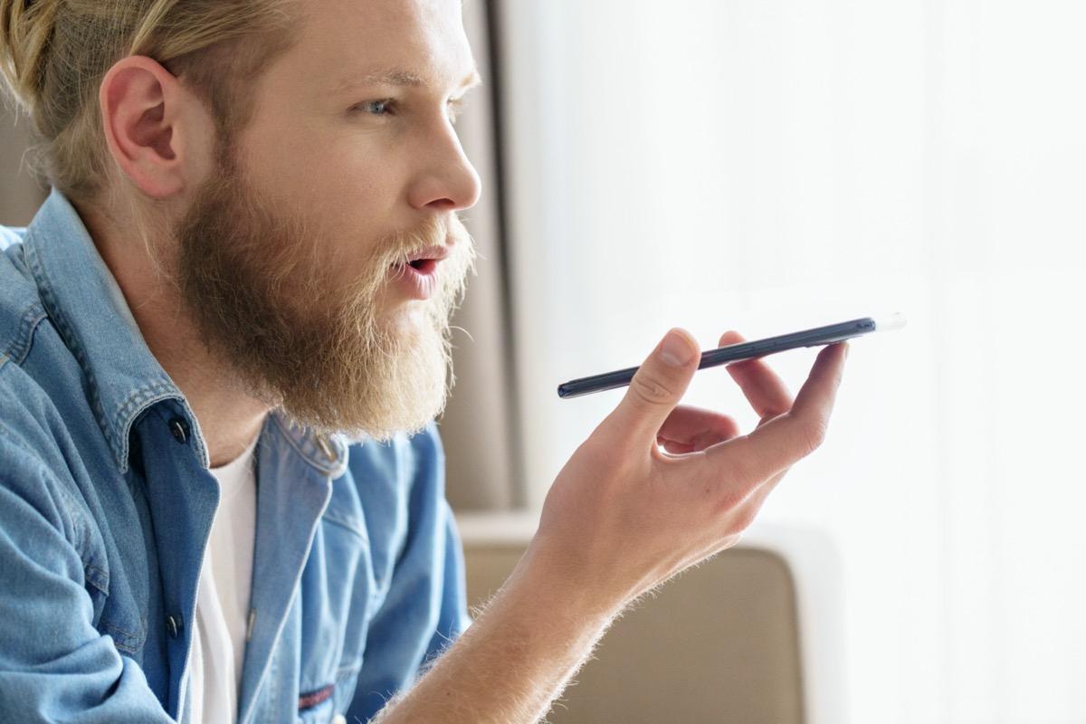 young white guy using speakerphone
