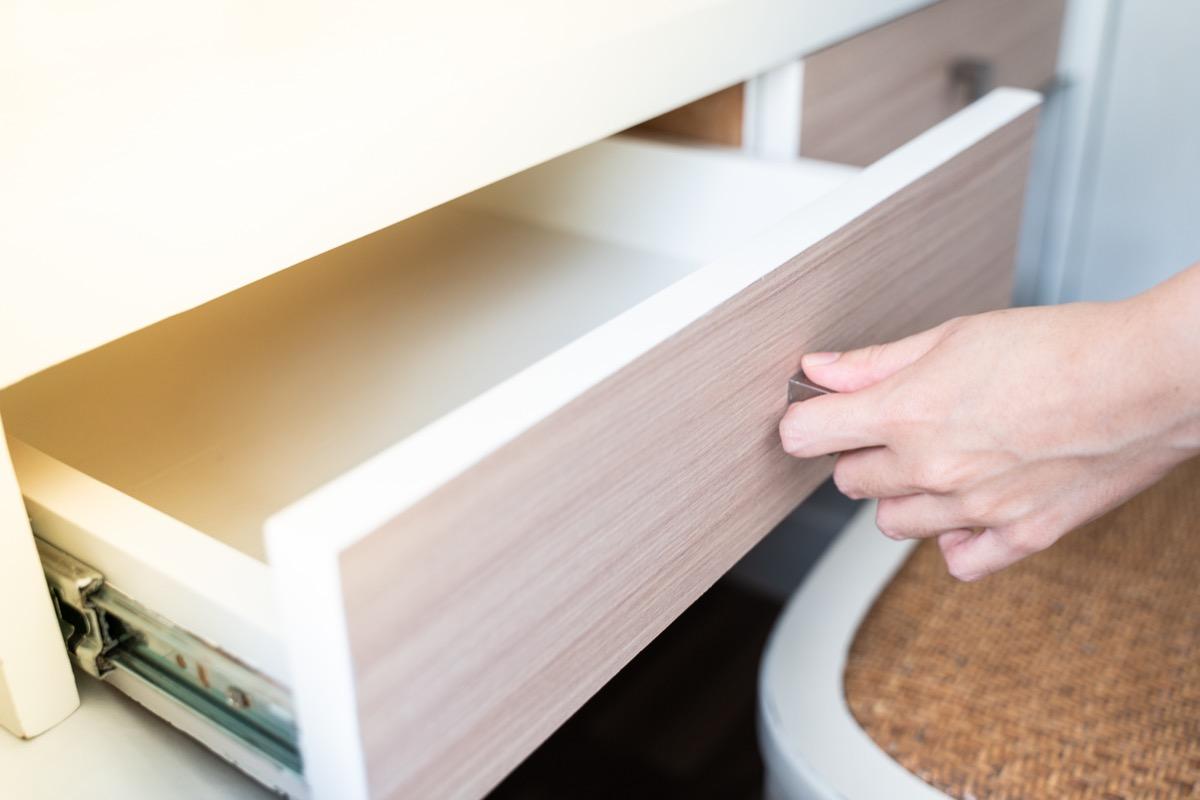 hand opening empty dresser drawer