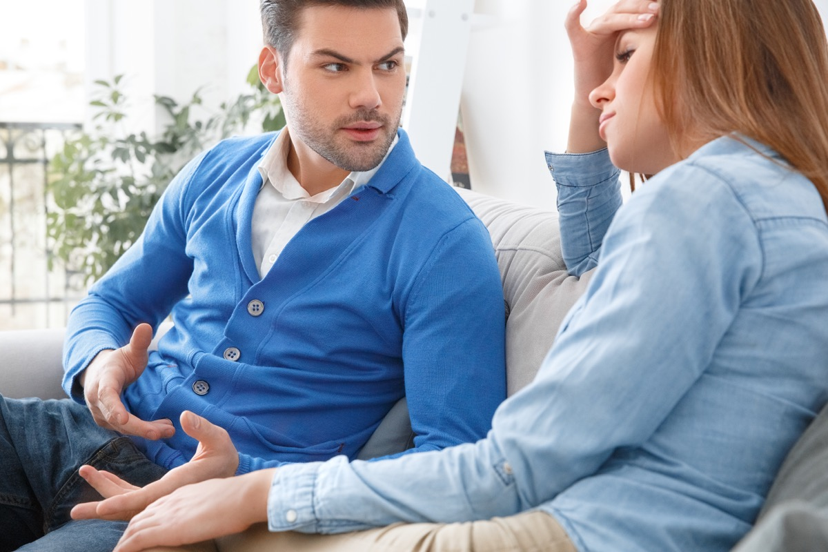 woman and man arguing on couch