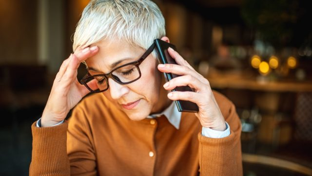 woman stressed out while she's on the phone