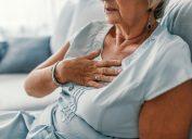 woman clutching her heart
