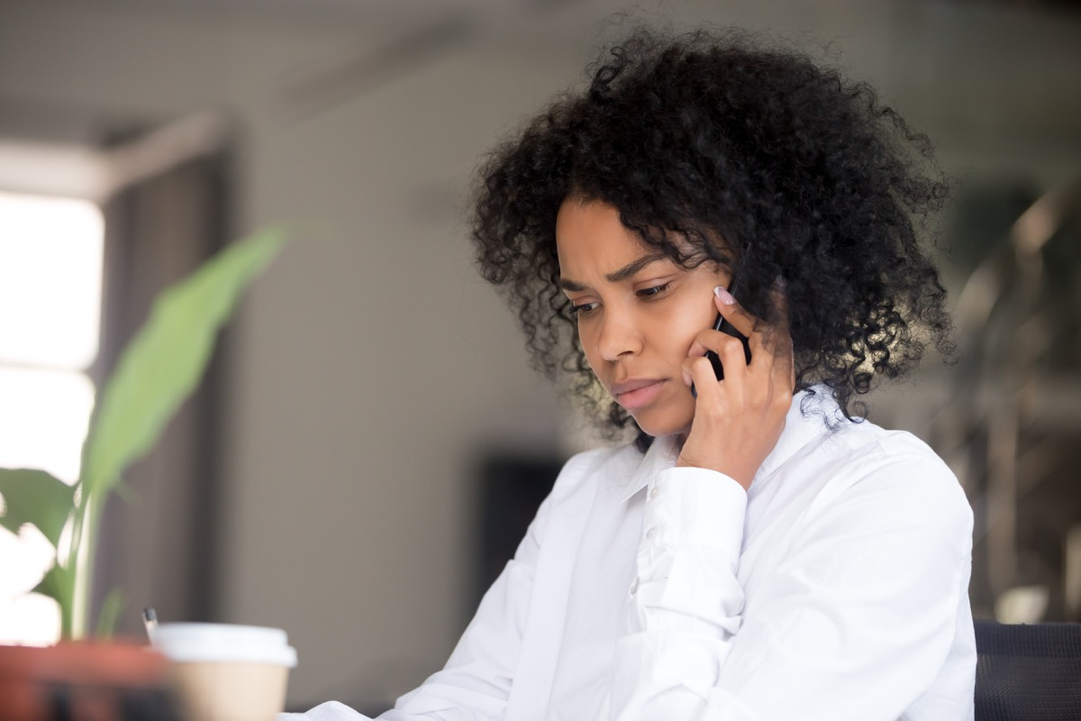 woman apologizing but confused over the phone