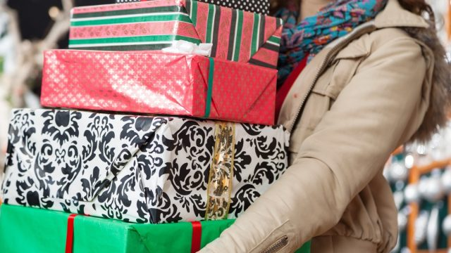 woman holding multiple gift boxes