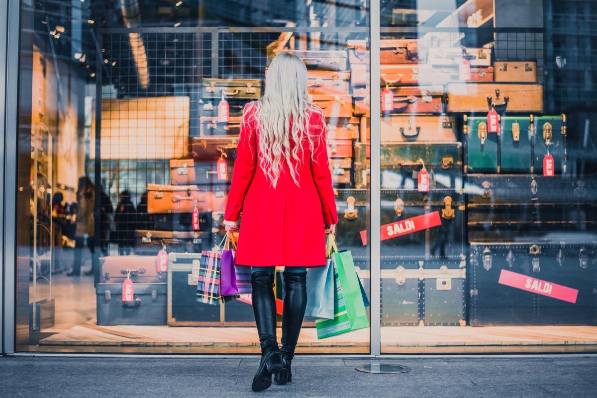 woman looking at shop display