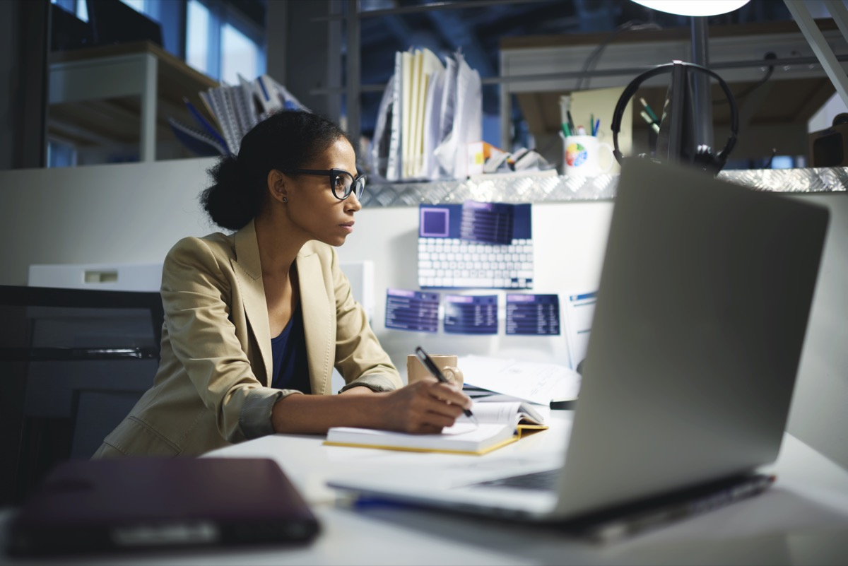 woman staying late at work