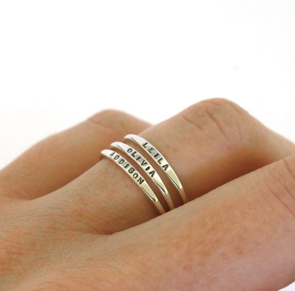 Stacking rings on woman's hand