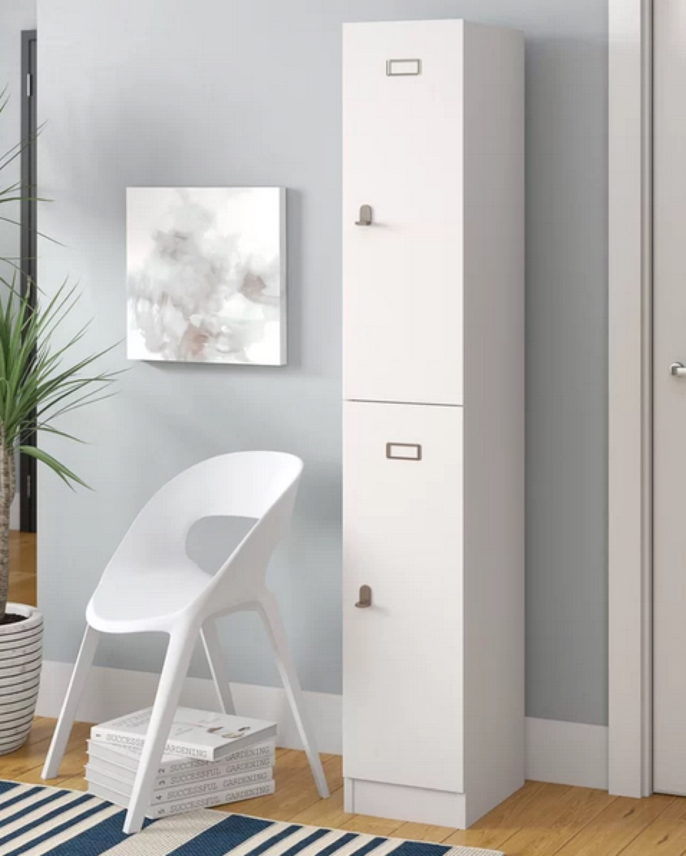 gray room with white lockers and chair