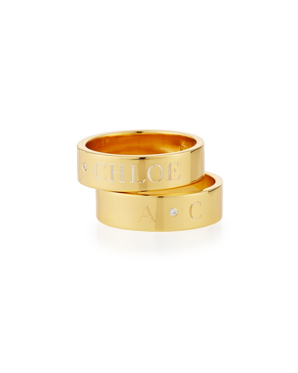 Two stacked gold rings, white background