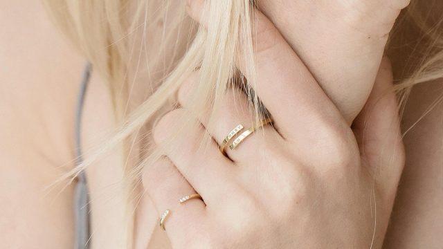 Blonde woman wearing wrap name ring