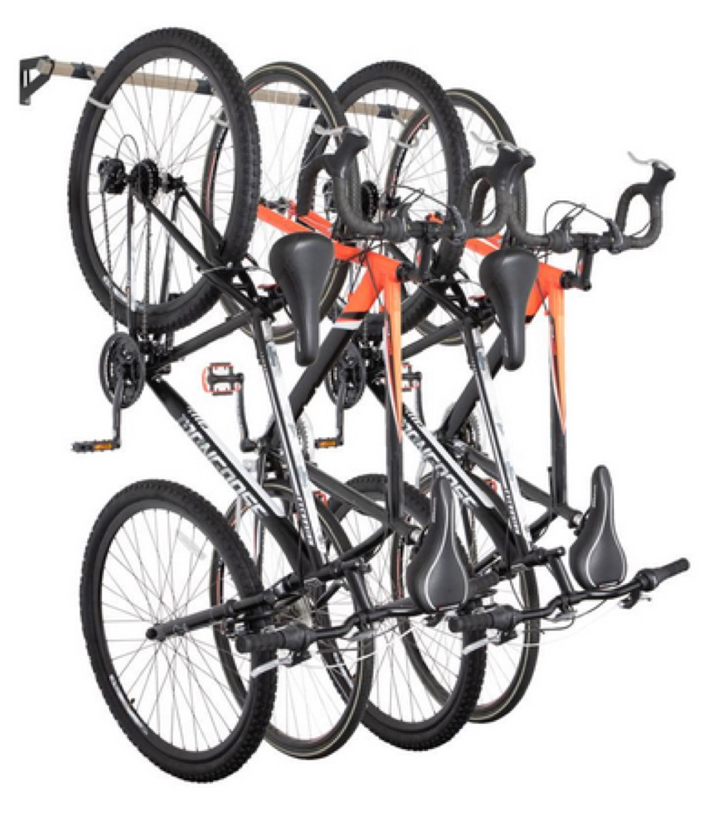 four bikes affixed to wall-mounted bike rack
