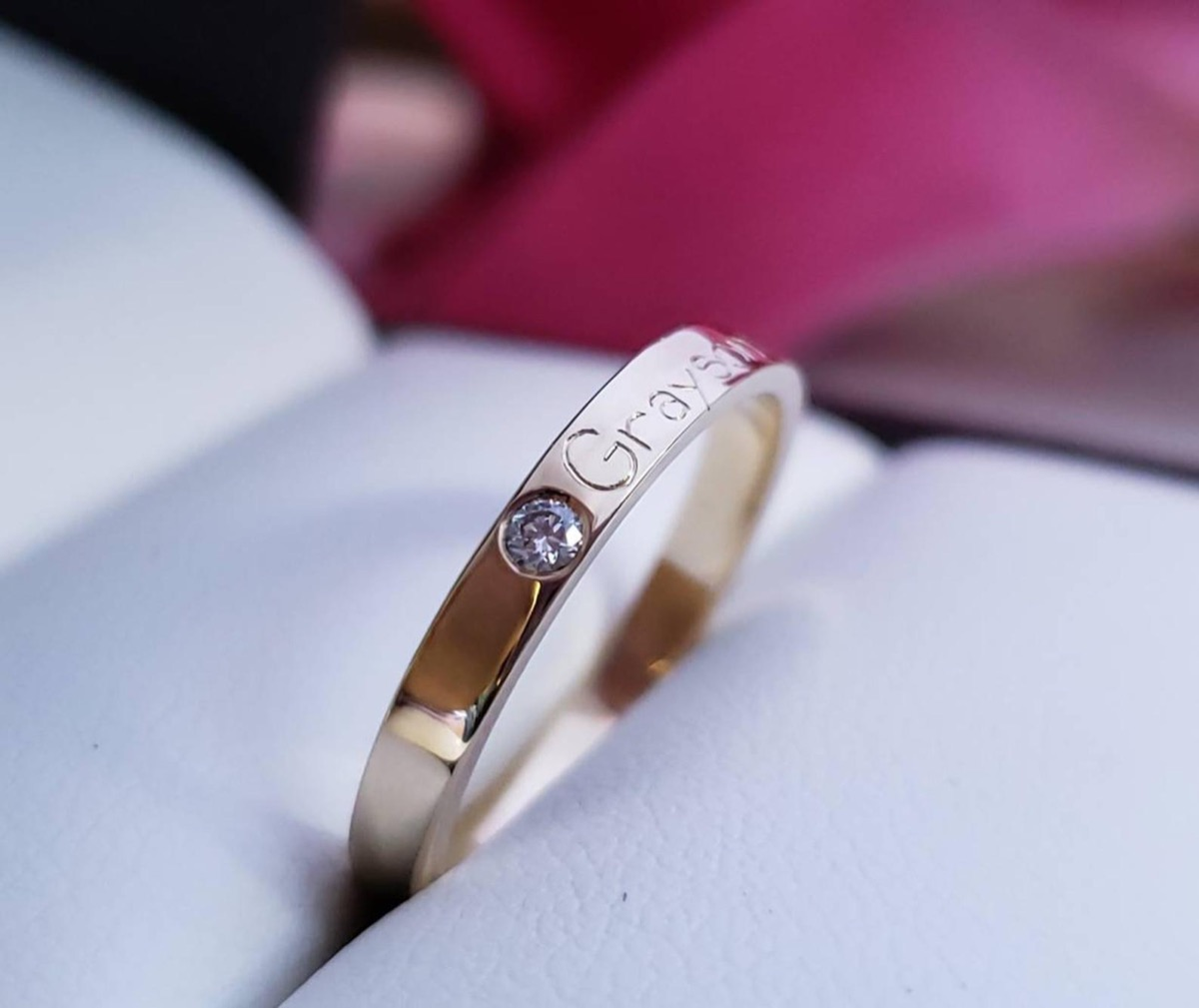 Name band with diamond accent in ring box