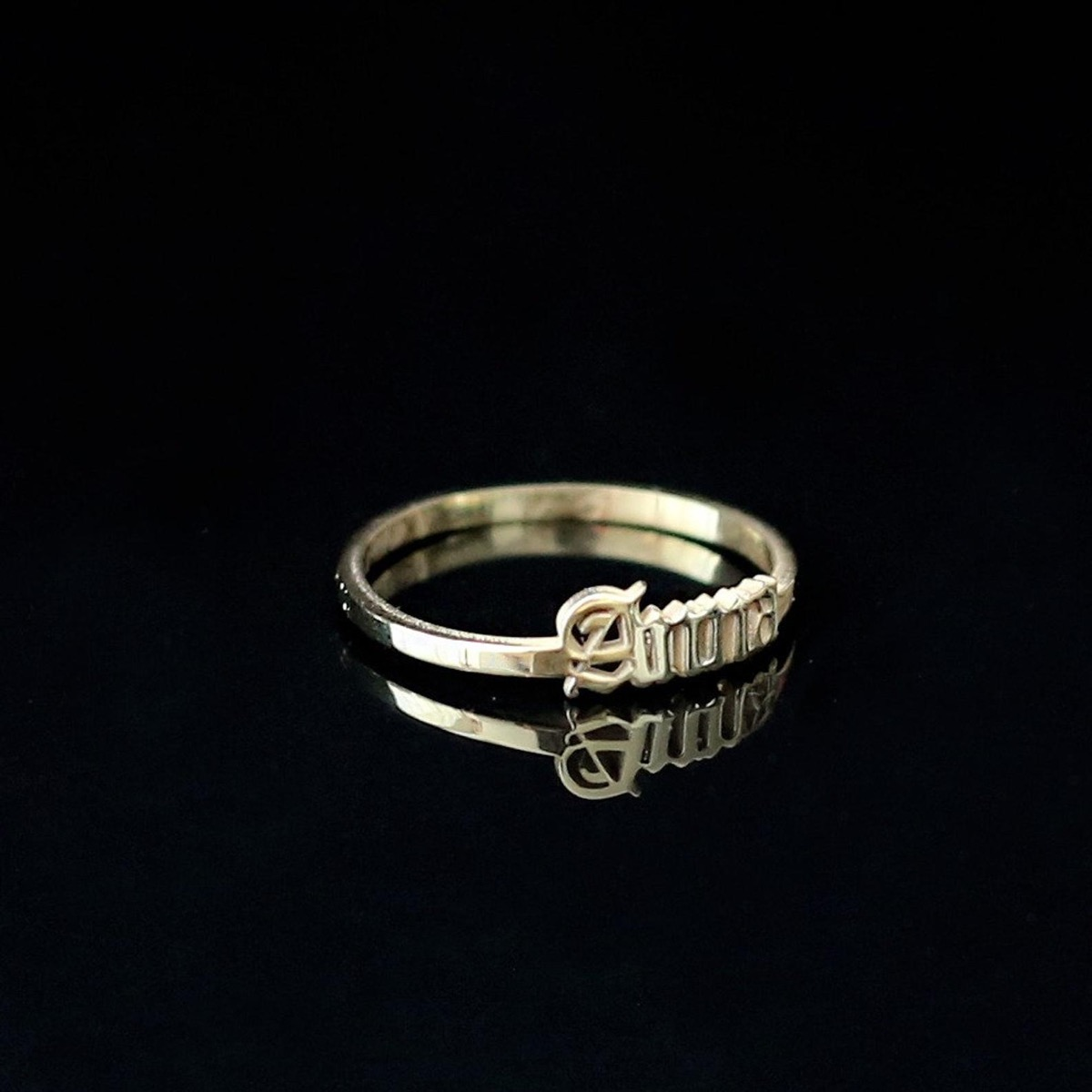 Gold gothic name ring, black background